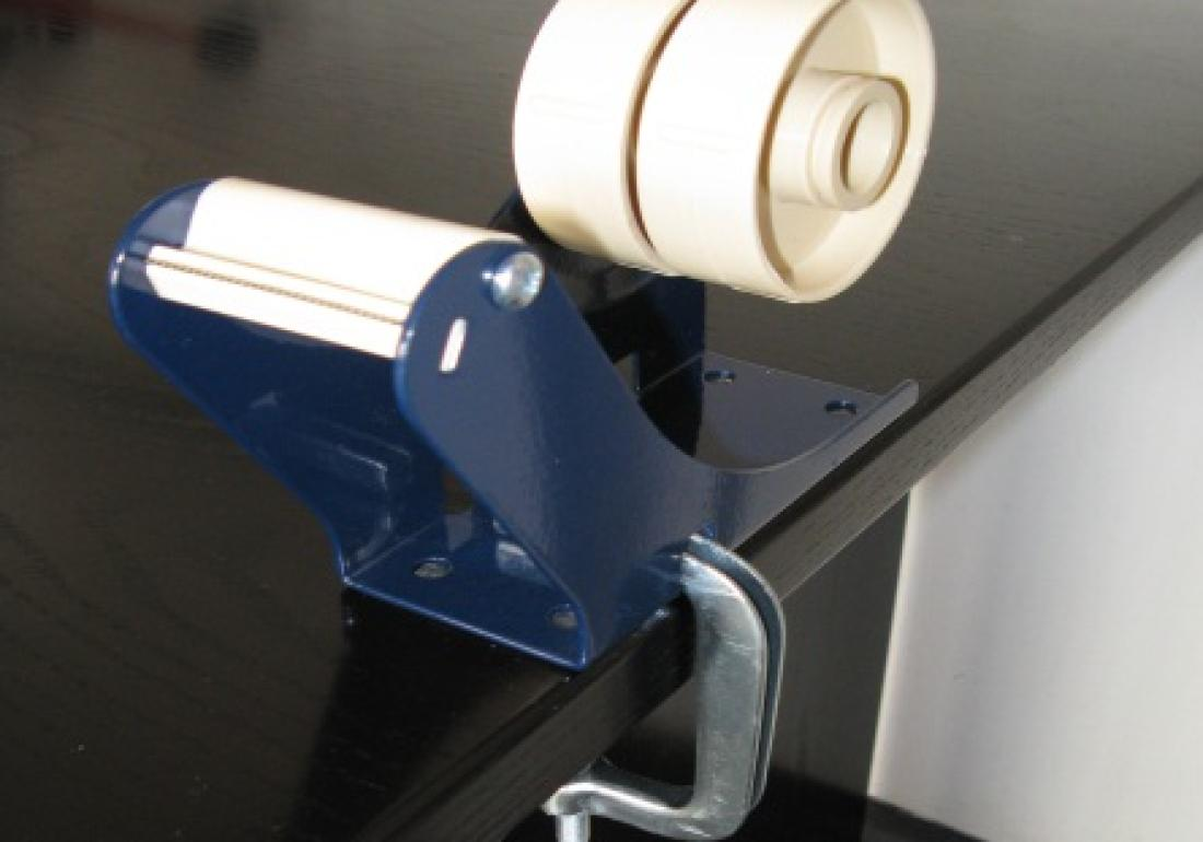 Table dispenser with clamp